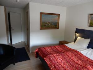 En eller flere senge i et værelse på Den gamle Kostald Bed & Breakfast