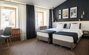 Cama o camas de una habitación en History hotel