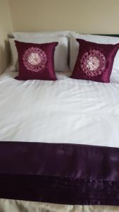 A bed or beds in a room at Lime House Hotel