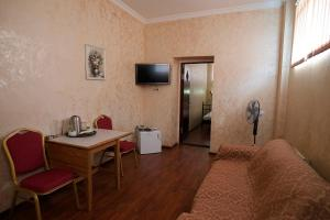 A television and/or entertainment center at Edem Hotel