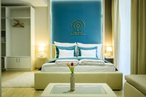 A bed or beds in a room at The Hotel Unforgettable - Hotel Tiliana by Homoky Hotels & Spa