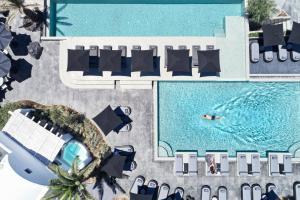 A view of the pool at OMMA Santorini or nearby