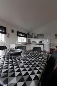 Un ou plusieurs lits dans un hébergement de l'établissement Guesthouse Brekka