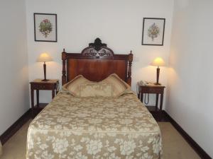 A bed or beds in a room at Hotel Rural Quinta de Santo Antonio