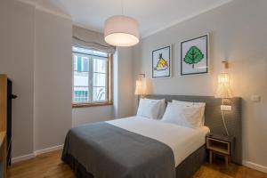 Cama o camas de una habitación en Urbano FLH Hotels Lisboa