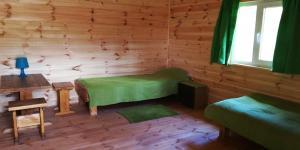 Кровать или кровати в номере Лесной Отель Берендеев Лес