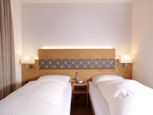 Ein Bett oder Betten in einem Zimmer der Unterkunft Landhaus Bolzum