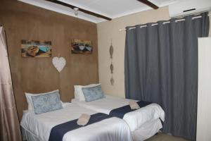 A bed or beds in a room at Cheese Farm & Lodge