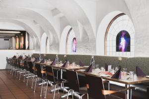 A restaurant or other place to eat at Augustin Hotel