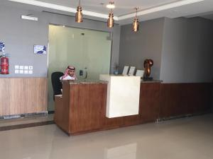 O saguão ou recepção de Arif Housing Units