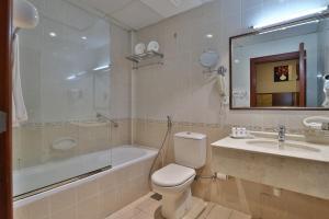 A bathroom at OYO 101 Click Hotel