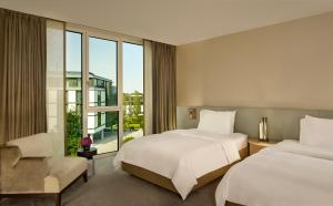 A bed or beds in a room at The Ritz-Carlton, Wolfsburg