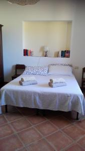 Кровать или кровати в номере Agriturismo La Steccaia Alta