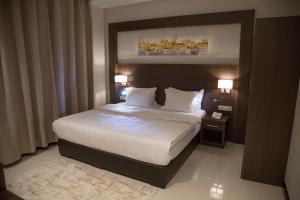Cama ou camas em um quarto em Emerald Residence