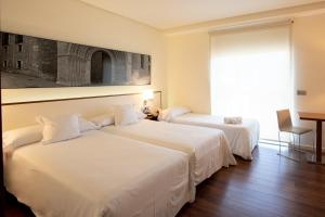 A bed or beds in a room at Primus Valencia