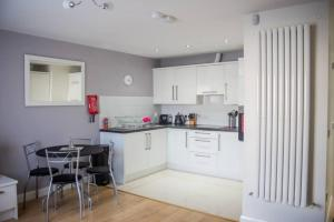 A kitchen or kitchenette at Holywell Way Swords