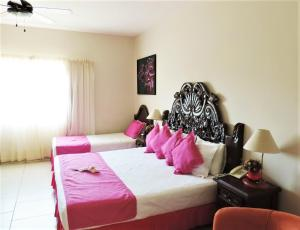 A bed or beds in a room at Marina Banderas Suites Hotel Boutique