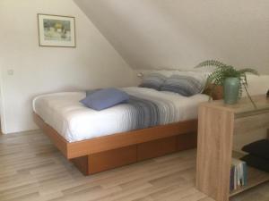 Een bed of bedden in een kamer bij B&B De Eikenhorst
