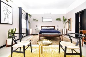 A bed or beds in a room at Atelier Boutique Hotel