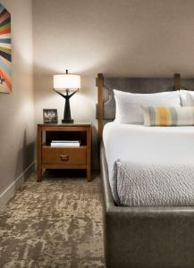 A bed or beds in a room at Tempe Mission Palms, a Destination by Hyatt Hotel