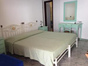 A bed or beds in a room at Hotel Villaggio Stromboli - isola di Stromboli