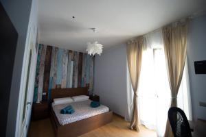 A bed or beds in a room at Villa Carrara