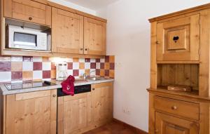 A kitchen or kitchenette at Résidence Odalys Rochebrune