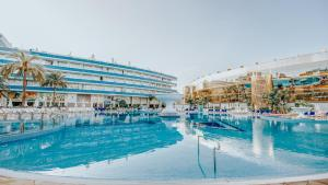 The swimming pool at or near Mediterranean Palace