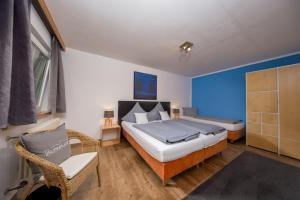 Ein Bett oder Betten in einem Zimmer der Unterkunft Alpinplus