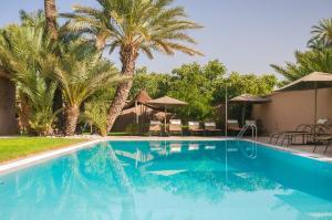The swimming pool at or near Dar Chamaa