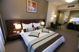 Кровать или кровати в номере Спа-отель Best Western Русский Манчестер