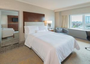 A bed or beds in a room at The Westin Nova Scotian