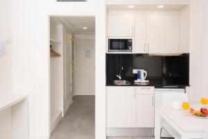 Een keuken of kitchenette bij HSM Lago Park Apartments