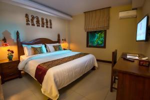 Ein Bett oder Betten in einem Zimmer der Unterkunft Royal Bagan Hotel