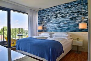 A bed or beds in a room at Pestana Berlin Tiergarten