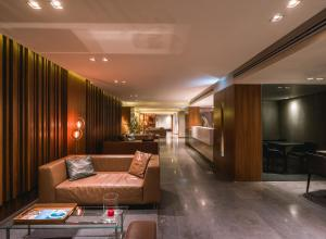 De lobby of receptie bij President Hotel