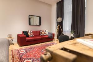 A seating area at TG Hotel Suites Budapest