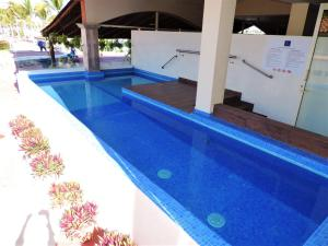 The swimming pool at or near Marina Banderas Suites Hotel Boutique