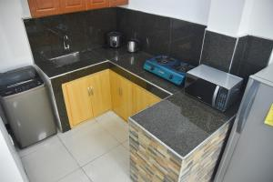 A kitchen or kitchenette at Furnished House in Calapan City Subdivision near ROBINSON/XENTRO Mall