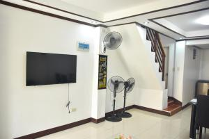 A television and/or entertainment center at Furnished House in Calapan City Subdivision near ROBINSON/XENTRO Mall