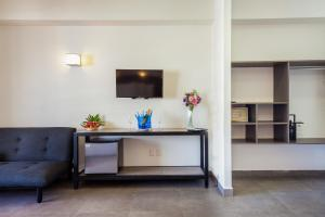 A television and/or entertainment center at Aspira Hotel & Beach Club