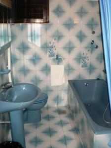 A bathroom at Apartments and Rooms Rogosic