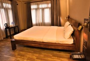 A bed or beds in a room at Sabila Boutique Hotel