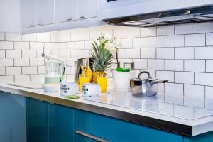 A kitchen or kitchenette at Casa Caribe Appartamento Attico