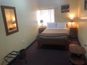 A bed or beds in a room at Hospedaje Turistico Recoleta