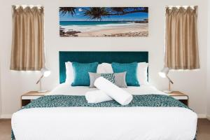 A bed or beds in a room at Ocean Views Resort Caloundra