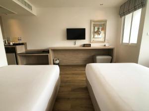 Letto o letti in una camera di Methavalai Residence Hotel