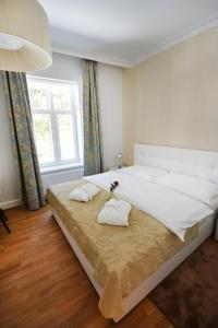 A bed or beds in a room at Hotel Solisko
