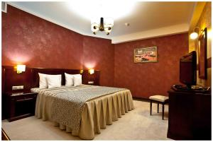 A bed or beds in a room at President Resort Hotel