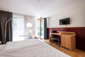 A bed or beds in a room at Ringhotel Schorfheide, Tagungszentrum der Wirtschaft